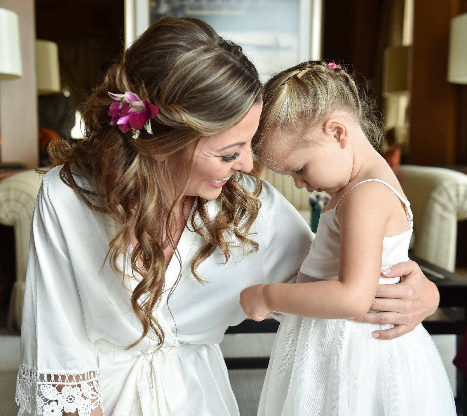 Cute photo of a bride with her flower girl at the Peninsula Hotel, Bangkok