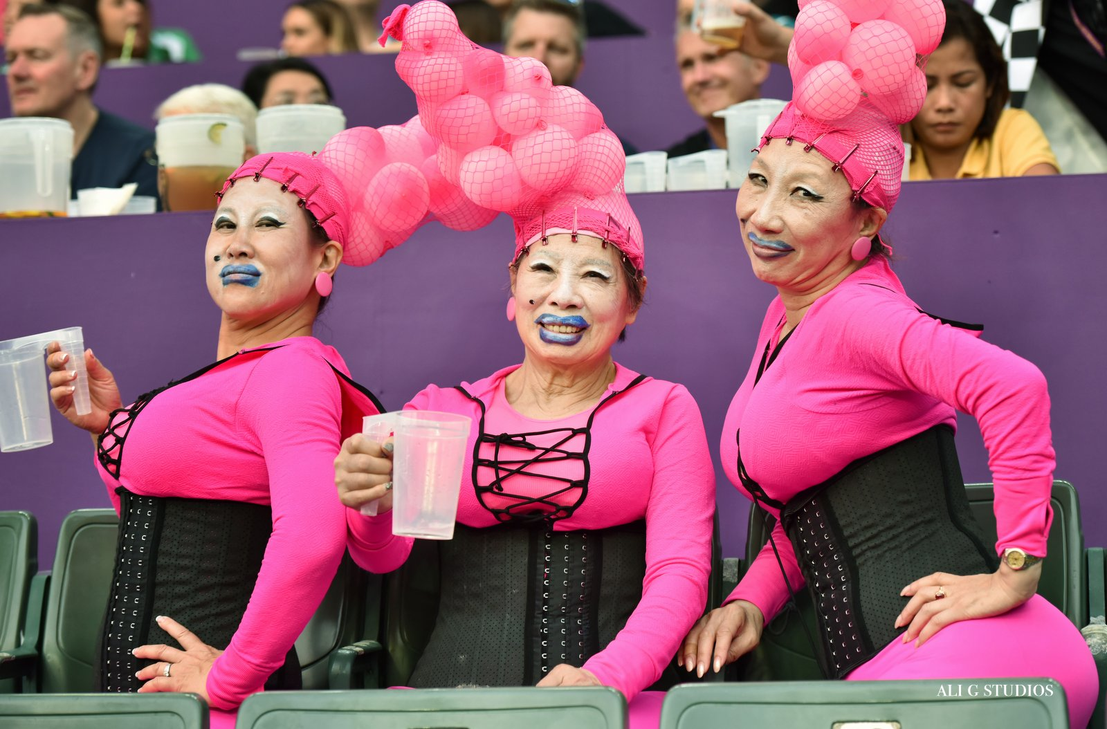 Three colorfully dressed fans at the Hong Kong 7's